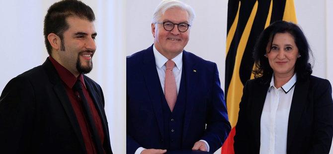 Almanya'dan iki Türk'e liyakat nişanı