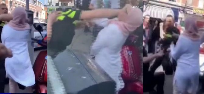 Hollanda polisi tekmeleyip yumruk attı