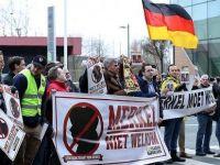 Merkel'i Belçika'da protesto ettiler