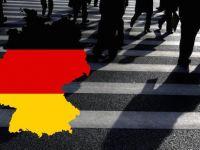 Almanya büyüme tahminini düşürdü