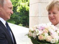 Merkel'e neden çiçek hediye ettiğini anlattı?