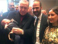 Erdoğan, gurbetçi bebeğe tam altın taktı